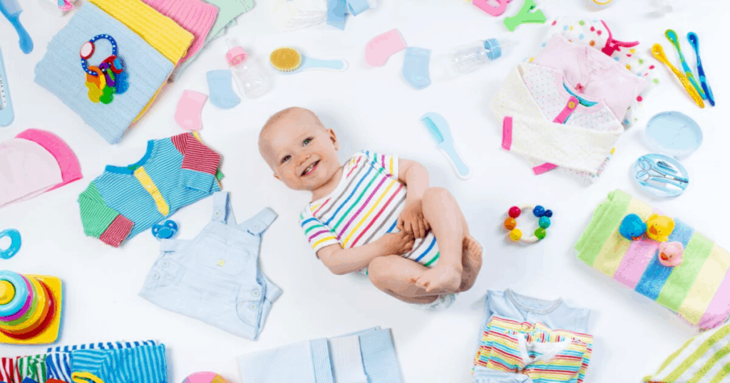 Baby surrounded by baby items